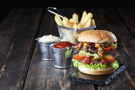 Large hamburger with fries, mayonnaise and ketchup LANG_EVOIMAGES