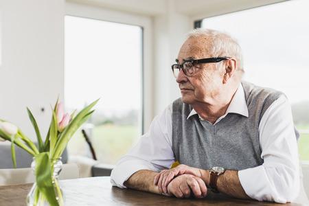 Senior man sitting at his living room