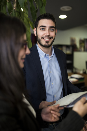 Portrait of smiling young man in office