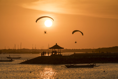 Indonesia, Bali, paragliders during sunset over the beach in Sanur LANG_EVOIMAGES
