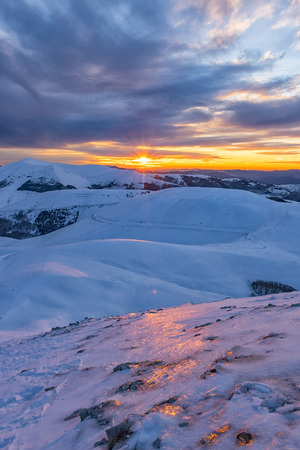 Italy, Umbria, Monti Sibillini National Park, Sunset on Apennines in Winter