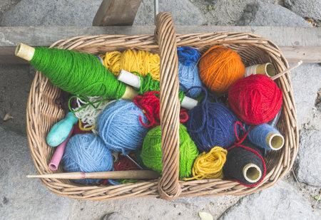 Balls of yarn in vintage basket LANG_EVOIMAGES