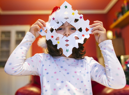 tinkered: Little girl with tinkered Christmas decoration LANG_EVOIMAGES