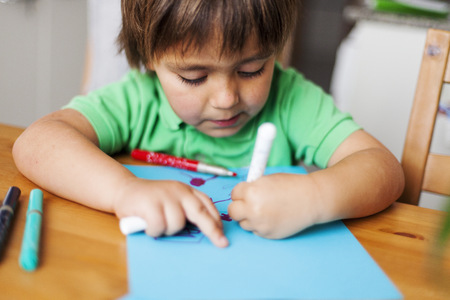 children painting: Portrait of little boy drawing