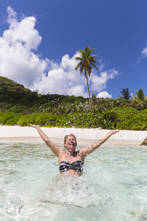 one mature woman only: Seychelles, Anse Cocos, female tourist in water