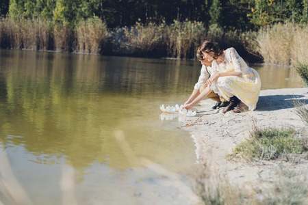 cowering: Lovers crouching side by side at waters edge