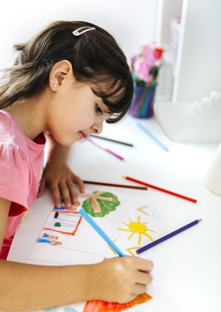 children painting: Little girl drawing on his desk at home