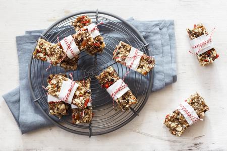 Homemade glutenfree, vegan granola bars on cooling grid LANG_EVOIMAGES