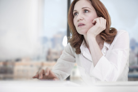 Woman at desk in office using computer