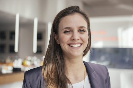 focus on foreground: Portrait of smiling young business woman