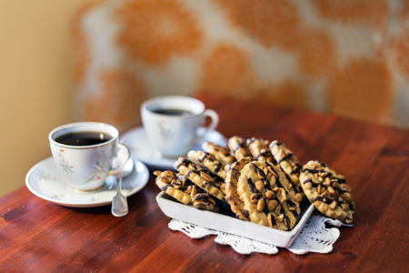 Cookies, bisquit on wood, two cups of coffee