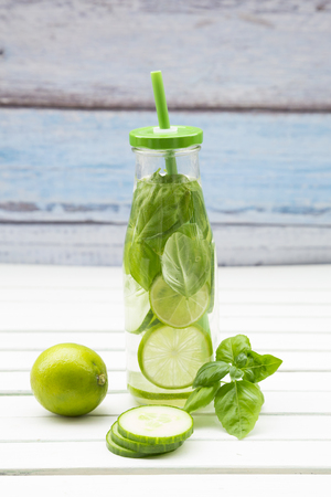 cucumis sativus: Glass bottle of infused water with lime, cucumber and basil