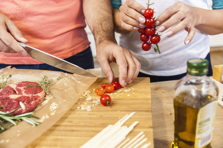 countertop: Slicing tomatoes on chopping board