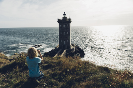 France, Brittany, Pointe de Kermorvan, Le Conquet, boy at lighthouse Phare de Kermorvan LANG_EVOIMAGES