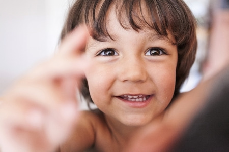 Portrait of smiling little boy with brown eyes LANG_EVOIMAGES