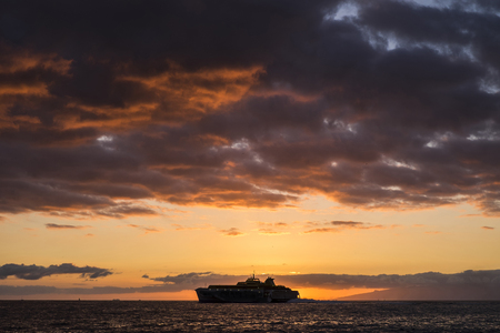 Spain, Tenerife, Ship on the ocean at sunset LANG_EVOIMAGES
