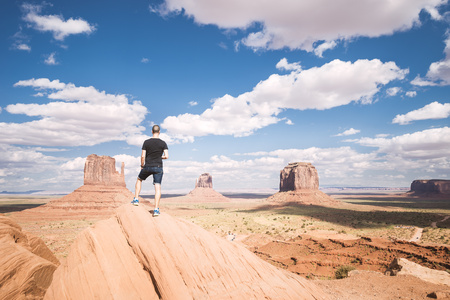 clime: USA, Utah, Tourist looking to Monument Valley