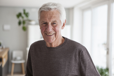 likeable: Portrait of smiling senior man at home