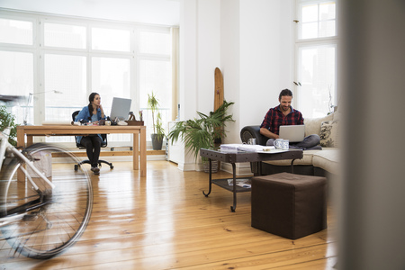 economic cycle: Two creative business people working in informal office