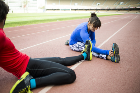 Athletes training for race in stadium