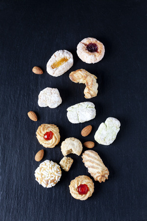 sorts: Different sorts of Italian almond cookies and almonds on slate LANG_EVOIMAGES