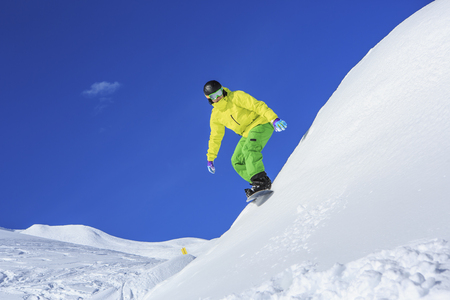 A snowboarder, snowboarding in Alps in Lech, Austria