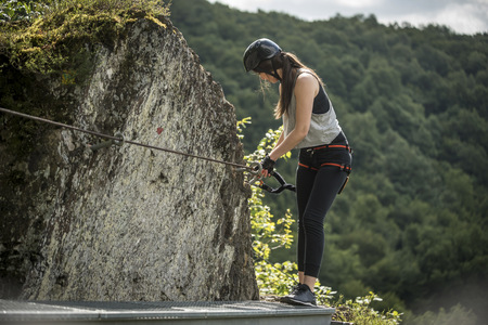 Germany, Westerwald, Hoelderstein, woman climbing on via ferrata LANG_EVOIMAGES