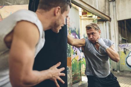 tough: Boxer exercising at punch bag