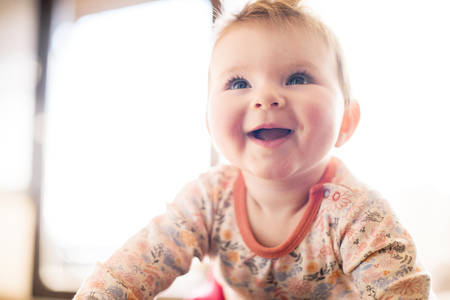ardor: Portrait of smiling baby girl looking up LANG_EVOIMAGES