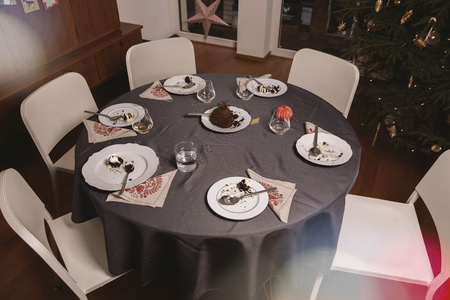 dining table and chairs: Table left after Christmas pudding