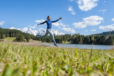 Germany, Bavaria, carefree woman at lake Barmsee LANG_EVOIMAGES