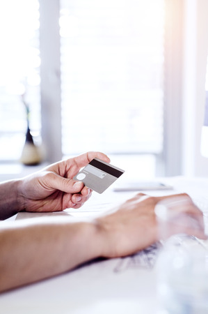 card making: Man making online payment with credit card