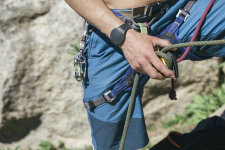 Hand of a climber securing during climbing