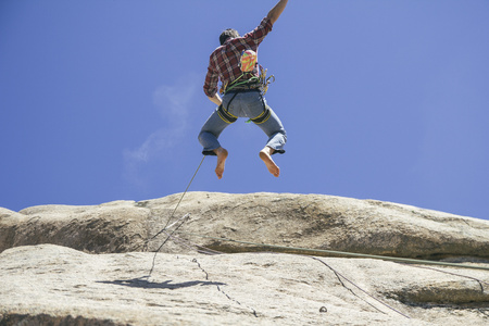 Climber jumping in a wall LANG_EVOIMAGES
