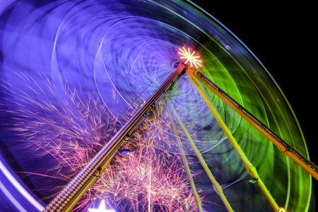Big wheel and fireworks at night