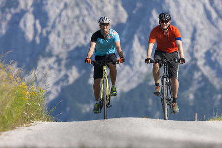 Two men on a bicycle tour with trekking bikes LANG_EVOIMAGES