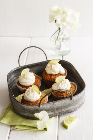 cup four: Four lime cup cakes with cream cheese topping on metal tray