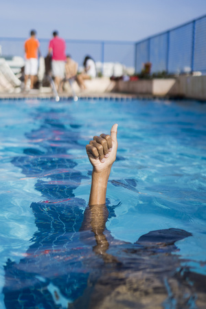 sinking: Hand of a boy inside swimming pool LANG_EVOIMAGES