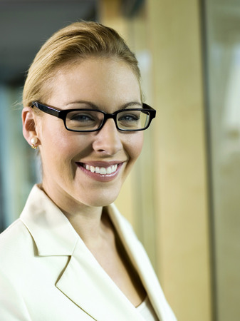 Young Businesswoman Wearing Spectacles, Smiling, Close-Up, Portrait LANG_EVOIMAGES