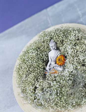 Buddha Figurine Embedded On BabyS Breath (Gypsophila)