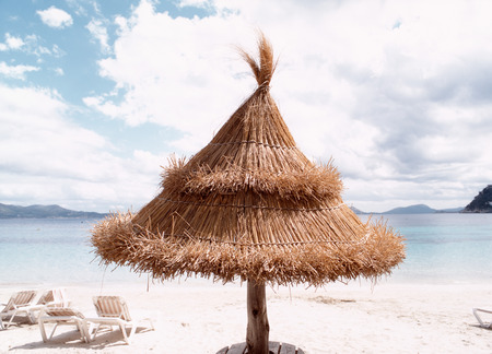 Beach Umbrella And Chairs On Beach