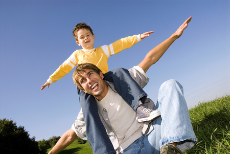 Boy (4-7) Sitting On Fathers Shoulders, Arms Out LANG_EVOIMAGES