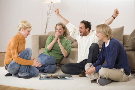 jubilating: Family Playing Board Game, Man With Arms Outstretched, Smiling LANG_EVOIMAGES