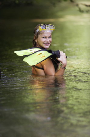 Teenage Girl (13-15) Standing In River, Holding Flippers, Portrait