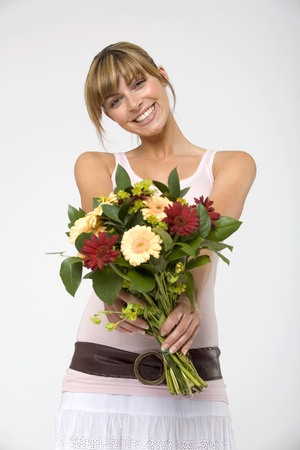 looking for love: Young Woman Holding Bouquet,Smiling,Portrait,Close-Up