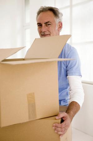 alteration: Mature Man Holding Carton,Portrait,Smiling
