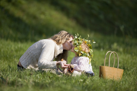 Mother And Daughter In Meadow, Doughter Wearing Wreath On Head