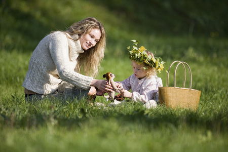 northern light: Mother And Daughter In Meadow, Doughter Wearing Wreath On Head
