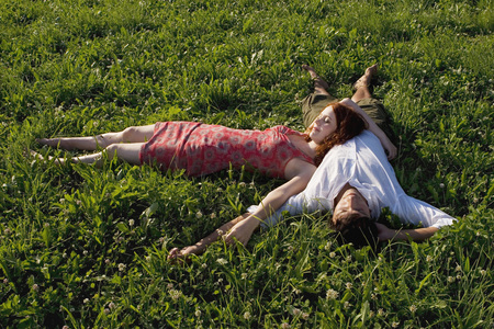 attachment: Woman Lying With Head On Man`S Belly In Meadow