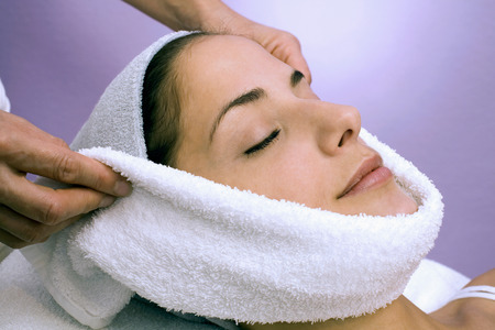 compress: Woman Receiving Face Treatment, Eyes Closed, Close-Up LANG_EVOIMAGES